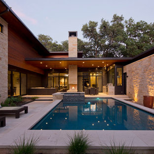 Inspiration for a contemporary backyard stone and rectangular hot tub remodel in Austin