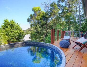 Circular plunge pool in timber deck