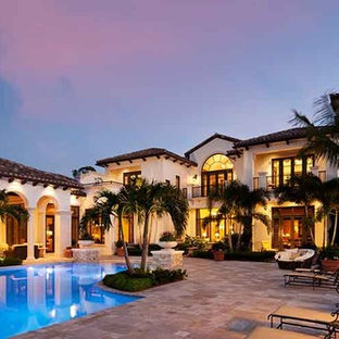 Photo of a large tropical custom-shaped pool in Miami with tile.