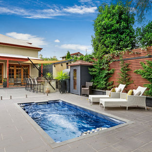 Traditional backyard rectangular lap pool in Melbourne with concrete pavers.