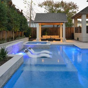 Hot tub - small contemporary backyard stone and rectangular natural hot tub idea in Houston