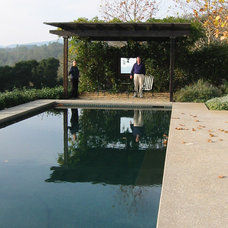 Modern Pool by Winder Gibson Architects
