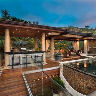 Foto de casa de la piscina y piscina infinita, clásica renovada, grande, rectangular, en azotea, con suelo de baldosas