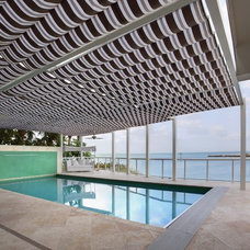 Contemporary Pool by Clifford M. Scholz Architects Inc.