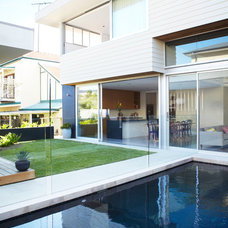 Modern Pool by Harrison's Landscaping