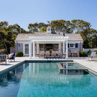 Pool house - large coastal side yard stone and rectangular pool house idea in Boston
