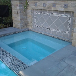 Coastal Cottage - recycled glass tile in a 1x4 pattern and a slate versailles.
