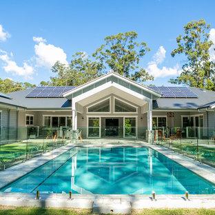 Inspiration for a transitional backyard rectangular lap pool in Sunshine Coast.