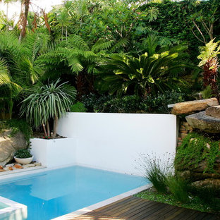 Photo of a contemporary rectangular pool in Sydney with a hot tub and decking.