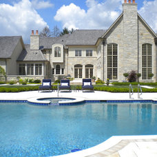 Traditional Pool by Bertog Landscape Company