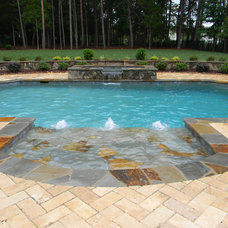 Traditional Pool by Charlotte Pools & Spa's Inc