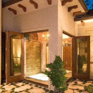 Foto de casa de la piscina y piscina alargada, clásica, grande, rectangular, en patio, con adoquines de piedra natural
