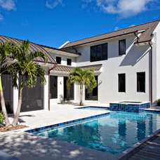 Tropical Pool by Village Architects AIA, Inc.