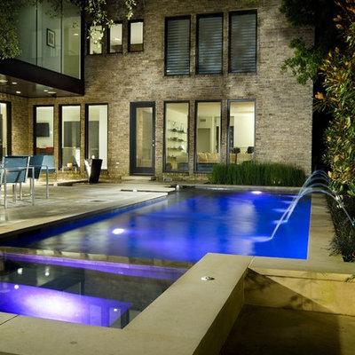 Pool - contemporary rectangular pool idea in Dallas