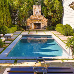 This is an example of a medium sized classic back rectangular swimming pool in Atlanta.