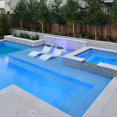 Inspiration for a small contemporary backyard stone and rectangular natural hot tub remodel in Houston