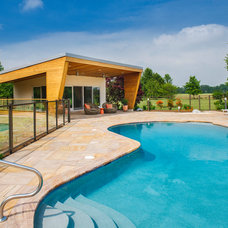 Modern Pool by New Outlooks Construction