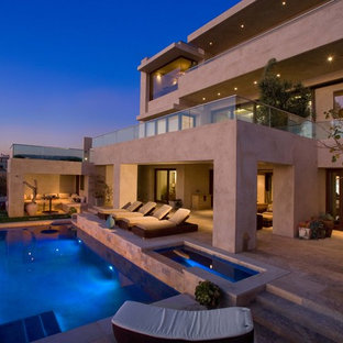 Inspiration for a contemporary rectangular pool remodel in Orange County