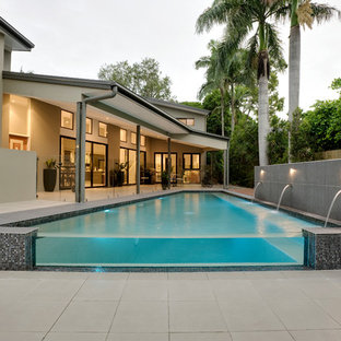 Contemporary rectangular pool in Brisbane with concrete pavers.