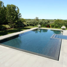 Contemporary Pool by J. Tortorella Swimming Pools