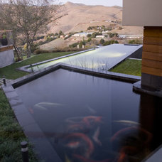 Contemporary Pool by modern house architects