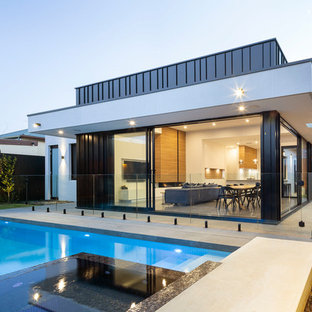 This is an example of a contemporary backyard rectangular pool in Adelaide with a water feature.