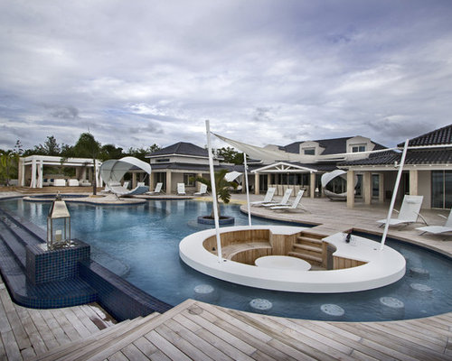 Inspiration For A Huge Contemporary Backyard Tile And Custom Shaped  Infinity Pool Remodel In Other