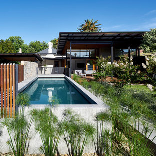 Photo of a contemporary backyard rectangular lap pool in Adelaide with concrete slab.