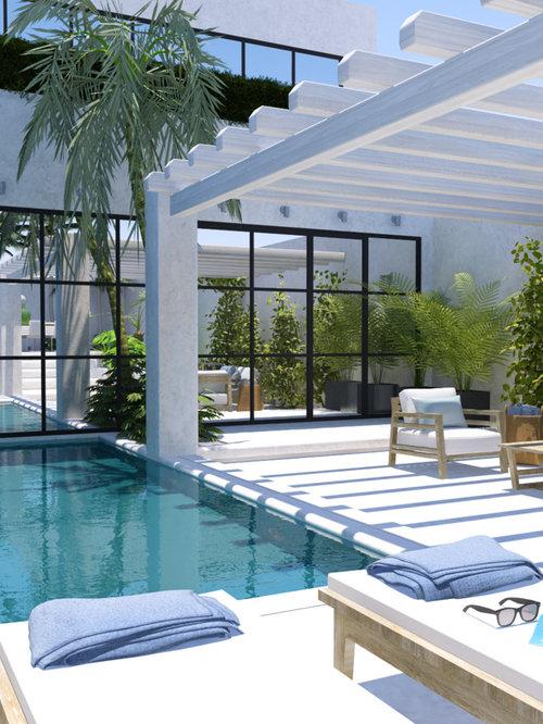 Fotos de piscinas dise os de piscinas elevadas en grecia for Piscina rectangular pequena