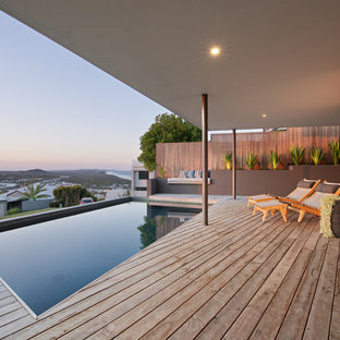 Design ideas for a mid-sized beach style rooftop rectangular lap pool in Sunshine Coast with decking.