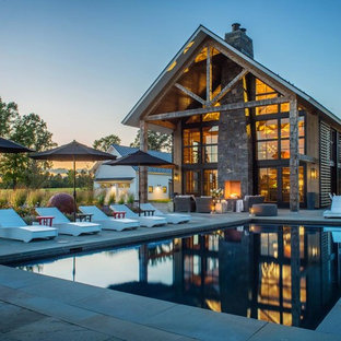 This is an example of an expansive country backyard rectangular pool in Burlington.