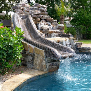 Inspiration for a mid-sized rustic backyard custom-shaped and stone lap water slide remodel in Little Rock