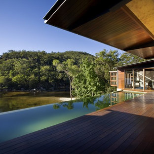 Pool - large contemporary rectangular infinity pool idea in Sydney with decking