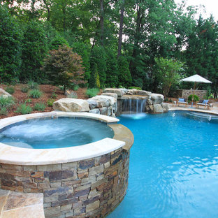 Inspiration for a rustic backyard stone and custom-shaped lap hot tub remodel in Raleigh