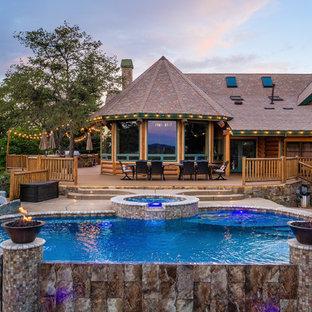 Mountain style backyard custom-shaped infinity hot tub photo in Sacramento