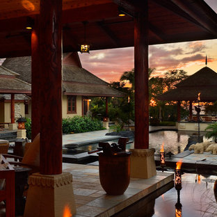 Imagen de piscinas y jacuzzis infinitos, de estilo zen, de tamaño medio, rectangulares, en patio, con adoquines de piedra natural