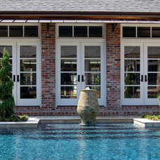 Traditional Pool by Daly-Sublette Landscape Architects