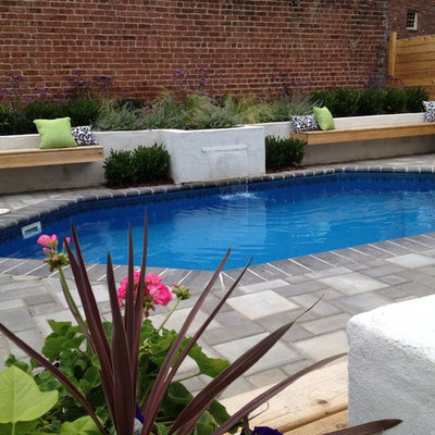 Pool fountain - mid-sized mediterranean backyard concrete paver and custom-shaped lap pool fountain idea in Richmond