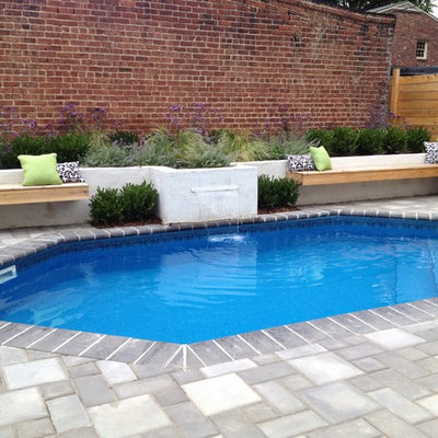 Mid-sized tuscan backyard concrete paver and custom-shaped lap pool fountain photo in Richmond