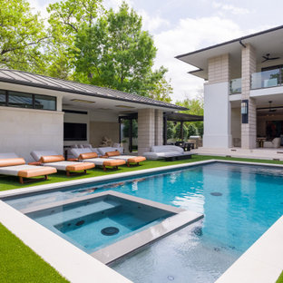 Expansive midcentury backyard rectangular pool in Dallas with a pool house and natural stone pavers.