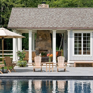 Inspiration for a country rectangular pool house remodel in New York