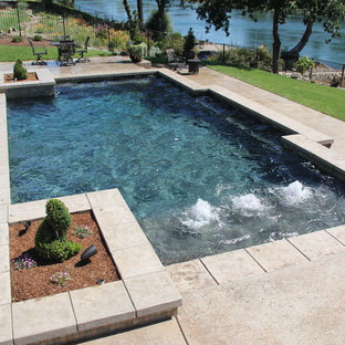 Example of a mid-sized trendy backyard concrete and rectangular aboveground pool fountain design in Other