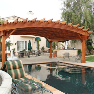 This is an example of an expansive arts and crafts backyard custom-shaped pool in San Francisco with a pool house and concrete slab.