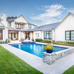 Traditional back rectangular swimming pool in Dallas with a hot tub.