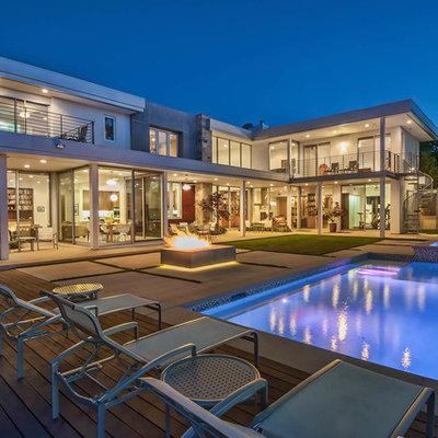 Example of a trendy backyard rectangular lap pool design in Los Angeles
