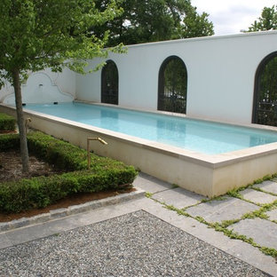 Inspiration for a large modern courtyard concrete paver and rectangular aboveground pool fountain remodel in Other