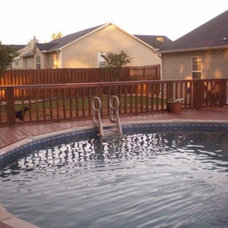 Traditional Pool by M.E.M. Remodeling & More