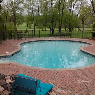 Inspiration for a mid-sized timeless backyard concrete paver and kidney-shaped lap pool remodel in Detroit