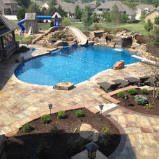 Traditional Pool by Landmark Landscape and Construction
