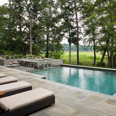 Example of a mid-sized trendy backyard tile and rectangular lap pool fountain design in Philadelphia